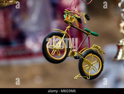 decorative toy bicycle made of waste material - Stock Photo