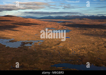 Paramotor flying over remote Rannoch Moor in the Scottish Highlands - Stock Photo
