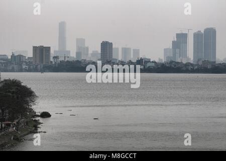 Hanoi, Vietnam - March 15, 2018: Skyline of Hanoi from the lake Thuy Kue - Stock Photo