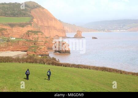 People walk on the South West Coast Path near Ladram Bay in East Devon - Stock Photo