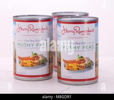 SWINDON, UK - MARCH 17, 2018: Three Tins of Harry Ramsden's Chip Shop Style Mushy Peas - Stock Photo