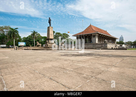 Wide angle view of Independence Memorial Hall on Independance Square in Colombo on a sunny day with blue sky. - Stock Photo