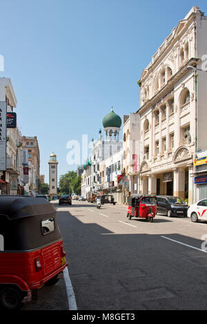 Typical street scene in the Fort area of Colombo know for its colonial buildings on a sunny day with blue sky and - Stock Photo
