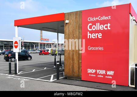 Red Tesco superstore supermarket click and collect under cover groceries facility in car park online internet grocery - Stock Photo