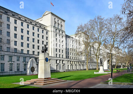 Winter view of government offices of the Ministry of Defence MOD main building Victoria Embankment Gardens including several war memorials London UK