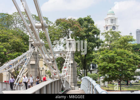 View of Cavenagh Bridge and Victoria Theatre tower from Empress Place, Civic District, Singapore Island, Singapore - Stock Photo