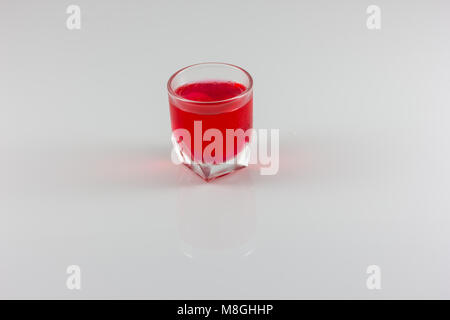 a glass of red water isolate in white background - Stock Photo