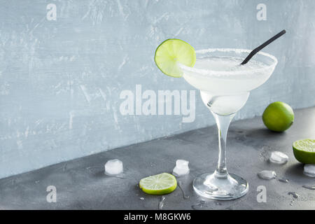 Margarita Сocktail with lime and ice on grey concrete background, copy space. Classic Margarita or Daiquiry Cocktail. - Stock Photo