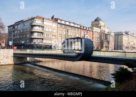Sarajevo, Bosnia and Herzegovina - 27 January 2018 - View of Sarajevo and Festina Lente bridge over river Miljacka, - Stock Photo