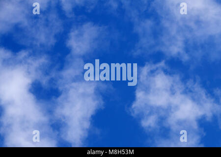 Angry funny fat face cloud in a blue sky for background or texture - Stock Photo