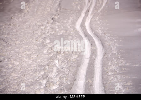Ski track on fresh snow. Winter sport background, cross-country skiing - Stock Photo