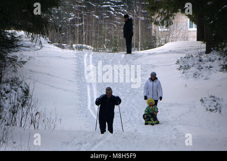 Laughing teenagers sledge downhill in wintertime enjoy snow - Russia Berezniki 16 Dec 2017 . - Stock Photo