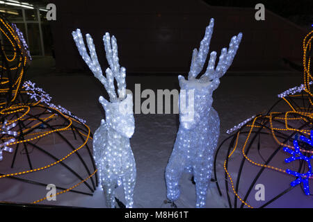 Christmas lights decoration in the shape of reindeer in Salerno during the artist lighting event, Italy - Stock Photo