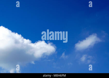 Light blue spring sky with clouds, may be used as background . - Stock Photo