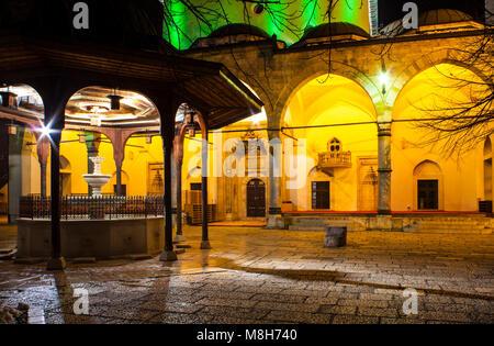 Night view of the Shadirvan Fountain on courtyard of Gazi Husrev-bey Mosque in Sarajevo - Stock Photo