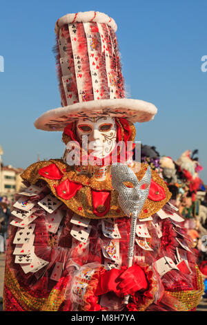 A jester, also joker or medieval fool, in beautiful colourful fancy dress costume and mask at the Venice Carnival, - Stock Photo