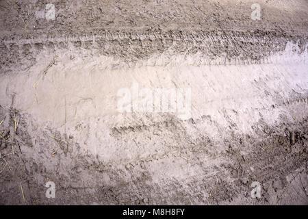 Closeup of country muddy rut slush soil - Stock Photo