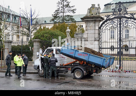 Bratislava, Slovakia. 16 March 2018. Police inspects the driver of the car that brought the cargo of manure in front - Stock Photo