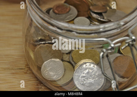 save up coins in glass - Stock Photo