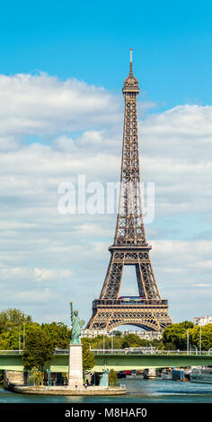 View of Eiffel Tower with Liberty statue copy on island in Paris with view of city on background - Stock Photo