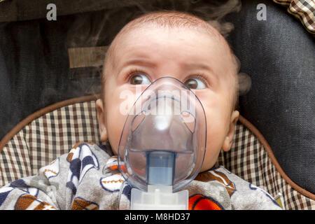mask inhalator on the child's face. Newborn - Stock Photo