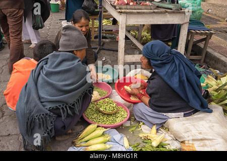 Otavalo, Ecuador - January 13, 2018: indigenous people in the Saturday farmer's market - Stock Photo