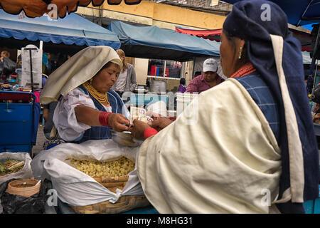 Otavalo, Ecuador - January 13, 2018: indigenous quechua women in the Saturday farmers market - Stock Photo