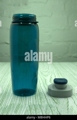 A blue sports drink water bottle isolated on a white background - Stock Photo