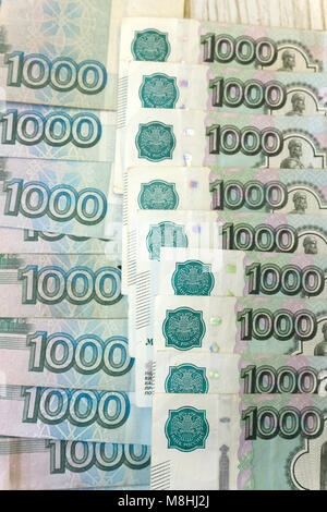 one-thousand rubles banknotes in shape of fan. russian paper money for backgrounds and illustration - Stock Photo