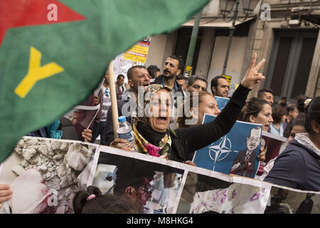 Athens, Greece, March 17, 2018 - Kurds hold placards depicting the atrocities takingplace in Afrin and shout slogans - Stock Photo