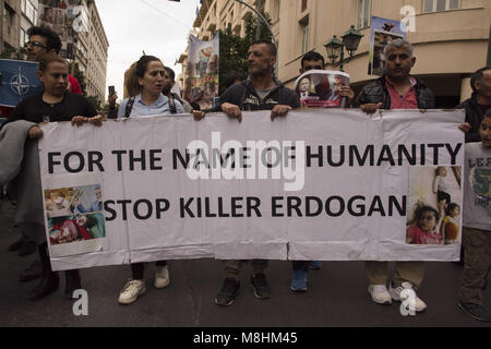 Kurds hold placards depicting the atrocities takingplace in Afrin and shout slogans against Putin and Erdogan. 17th - Stock Photo