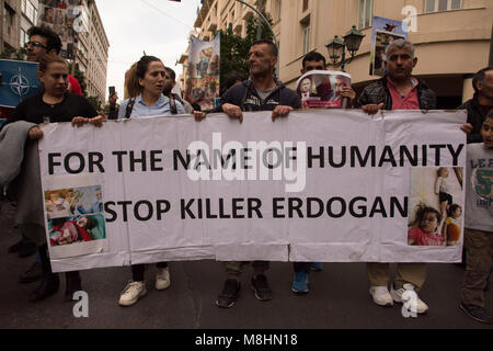Kurds hold placards depicting the atrocities takingplace in Afrin and shout slogans against Putin and Erdogan. Leftist, - Stock Photo