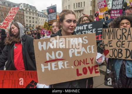 London, UK. 17th March 2018. A campaigner holds a poster 'Hate Has NO Place Here, Only Love' before the march through - Stock Photo