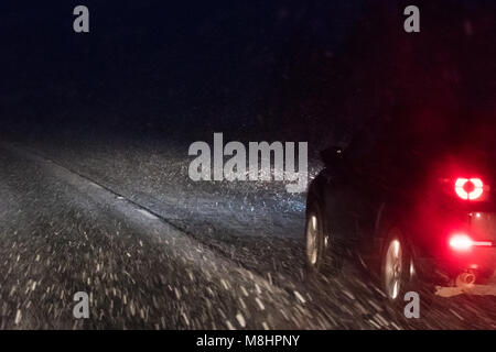 M74, Glasgow - 17 March 2018: UK weather - snow showers on the M74, south of Glasgow, Scotland Credit: Kay Roxby/Alamy - Stock Photo