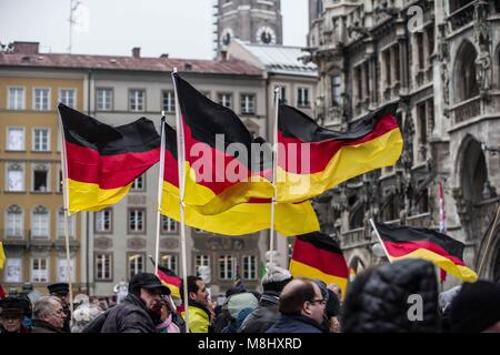 Munich, Bavaria, Germany. 17th Mar, 2018. German flags being waved by far- and extreme-rightists at a Pegida rally - Stock Photo