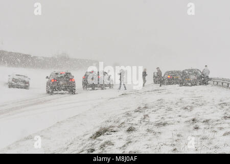 Long Bredy, Dorset, UK.  18th March 2018.  UK Weather.  People out of their vehicles after an accident involving - Stock Photo