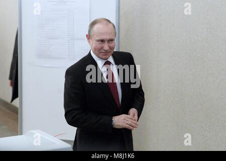 Moscow. 18th Mar, 2018. Russian President Vladimir Putin leaves a polling station after voting in Moscow March 18, - Stock Photo