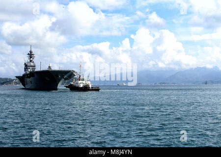 The Izumo-class helicopter destroyer of Japan Maritime Self-Defense Force (JMSDF) anchored at Cam Ranh port, Vietnam. - Stock Photo