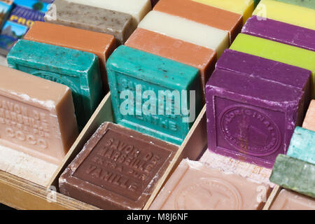 Different flavored bars of soap of traditional Savon de Marseille - Stock Photo