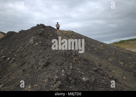Man running on Capelhinos desert, Ponta dos Capelinhos, Faial, Azores islands, Portugal - Stock Photo