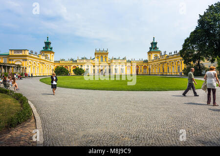 WARSAW, POLAND - JULY 26, 2014:  Wilanow Royal Palace main yard with tourists - Stock Photo