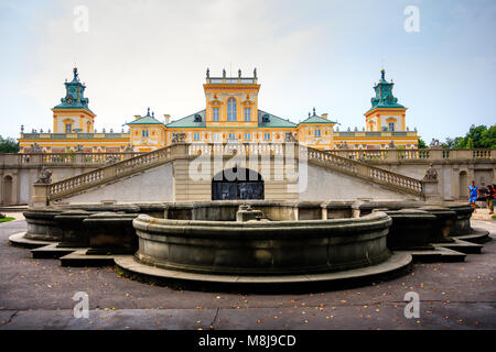 WARSAW, POLAND - JULY 26, 2014: Fountain at the Wilanow Royal Palace gardens and ancient statues - Stock Photo