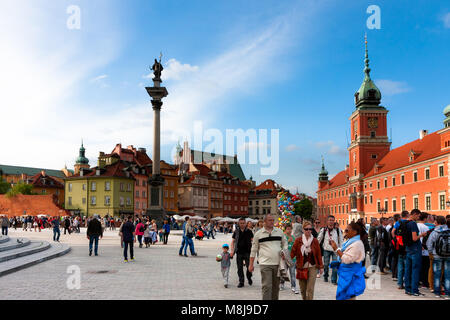 Castle Square full of tourists and Sigismund's Column, major tourist attractions of Warsaw. POLAND - MAY 18, 2014: - Stock Photo