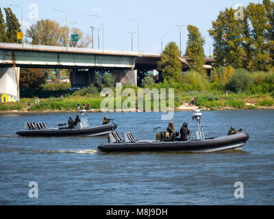Polish GROM Special Forces preparing for boarding a boat with terrorists from pontoons on the Vistula River. WARSAW, - Stock Photo