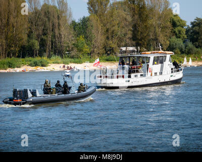GROM Special Forces preparing for boarding a boat with terrorists from pontoons on the Vistula River. WARSAW, POLAND - Stock Photo