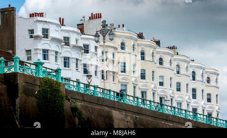 Row of classic grand terraced Victorian seafront homes overlooking Madeira Drive in Brighton - Stock Photo