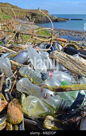 discarded plastic waste washed up on the beach at trabolgan on the southwest coast of ireland. - Stock Photo