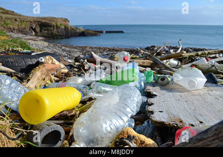 discarded plastic waste washed up on the beach at trabolgan on the southwest coast of ireland. - Stock Photo