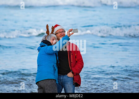 middle age couple taking a selfie at the coast - Stock Photo