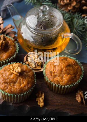 Home made Carrot spiced muffins with walnuts. Winter holiday treat - Stock Photo